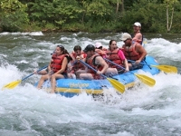 Photo of group in raft on river